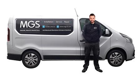 MGS commercial door service man and van